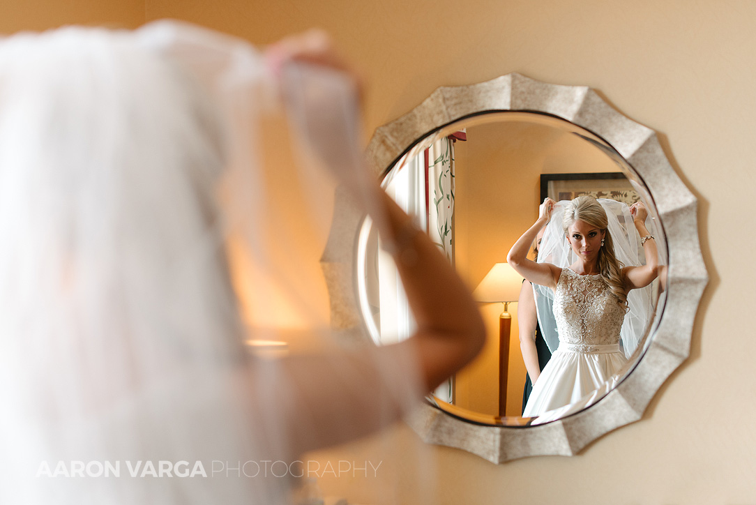 06 bride putting on veil in mirror - Gina + Chris | Oglebay Resort Wedding Photos