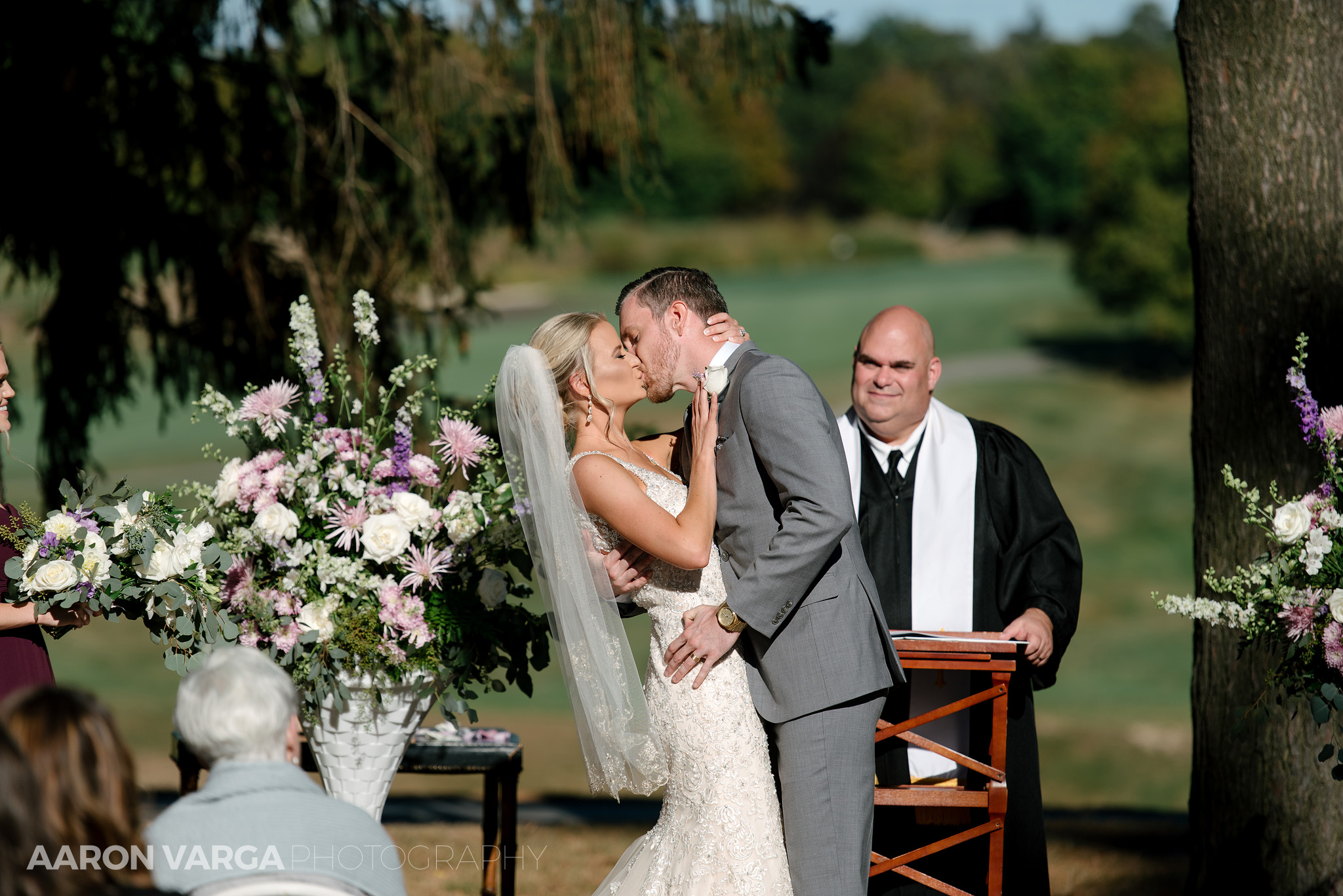 27 first kiss outdoor wedding ceremony - Amy + Bill | Montour Heights Country Club Wedding Photos
