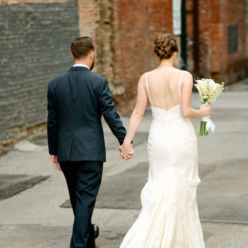 bride groom walking downtown 485x485 - Renaissance Hotel Wedding | Real Wedding | Shannon + Philip
